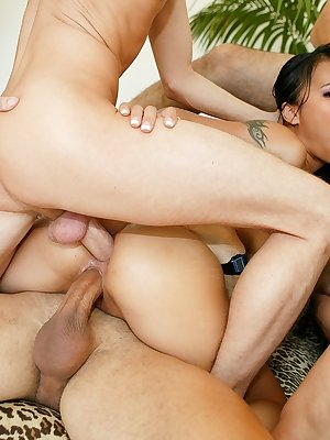 Hot Asian babe enjoys double penetration while giving a blowjob