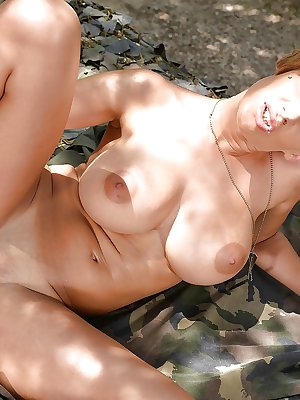 Busty blonde military dykes Loulou Petite and Danielle Maye kiss in forest