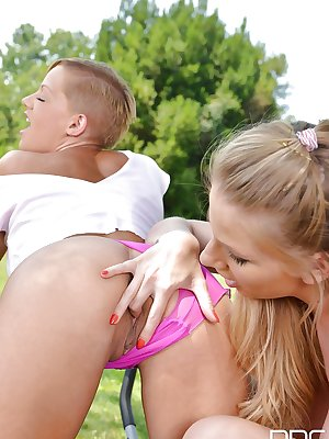 Euro lesbians Danielle Maye and Loulou Petite lick and finger cunts outside