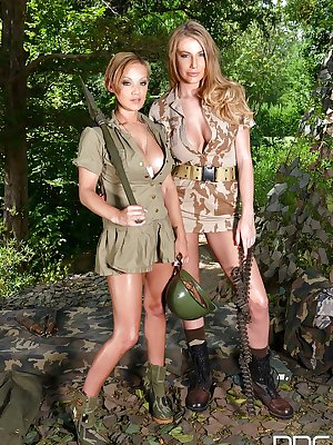 Busty dyke girls Loulou Petite and Danielle Maye toying twats in the forest