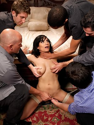 Submissive black-haired beauty gets dominated by a couple of men.