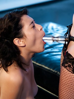 Lesbians Aiden Starr and Raven Rocket use a strapon and some dildos