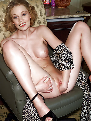 Graceful blonde babe with petite tits fisting her shaved pussy