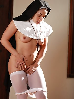 Naughty nun in white stockings Lea Lexis strips and masturbates on the floor