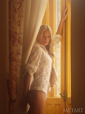 Stunning blonde chick Andrea C exposes herself in natural light
