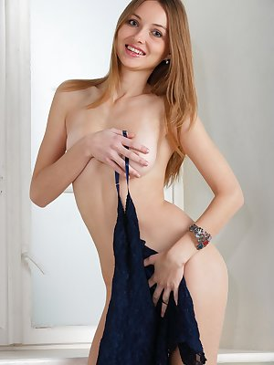 Russian girl Milagres A strips off her clothes for her nude modeling debut