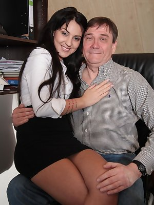 Brunette secretary Bella Beretta pleasures her older boss in his office