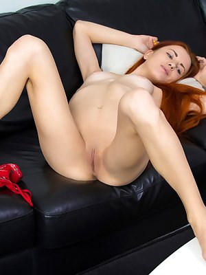Sexy redhead Katya Blue readies for a solo masturbation session