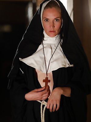 American nun Mona Wales prays for forgiveness before posing in the nude