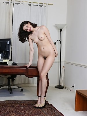 Teen first timer Felicity models naked except for a pair of high heeled shoes