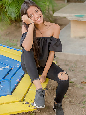 Smiley hot glamour girl Karin Torres looking sexy in ripped jeans on a swing