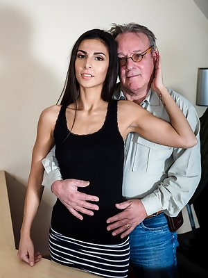 Young brunette and her really old boss fuck atop am office desk at work