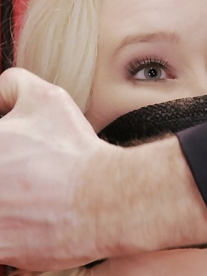 Blonde female Samantha Rone submits to being placed in bondage and ball gagged