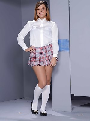 Schoolgirl in white socks and flat shoes takes off her cotton underwear