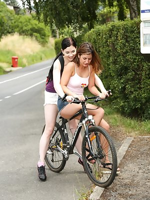 Young girls Lexi Rain and Daphne J bike out to the country for lesbian sex