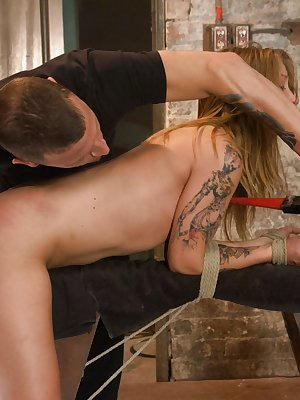 Tied up white chick Alyssa Branch is at the mercy of her handler
