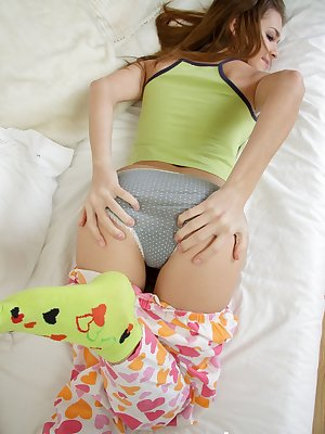 Cute teen girl Justine Hayes fingers her anus while toying her pussy