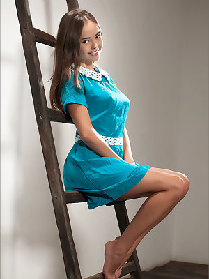 Little cutie in blue dress undressing to get on her knees and show young ass