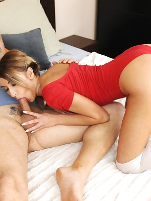 Young slut Katrin Tequila sucks the cum from an older man's cock in red onesie