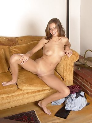 Charming babe Kelly masturbating passionately on the couch