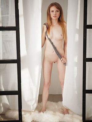 Erotic model Tempe rips her pantyhose to pose naked with legs spread