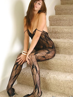 Amateur model London Hart struts on the stairs in a bodystocking