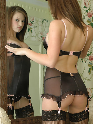 Sensual amateur Kate poses in the mirror in sexy lingerie and black stockings