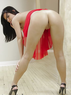 Brunette amateur Destiny Moody works her girl parts free of her red dress