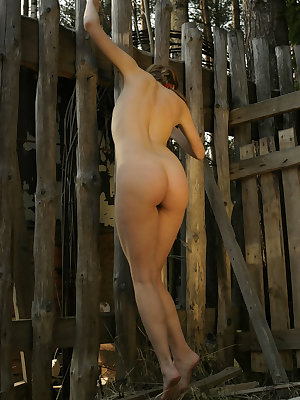 Erotic model Sveti strikes arousing poses naked outdoors at the cabin