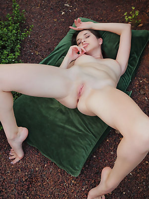 Erotic model Serena Wood stretches wide open outside on the ground
