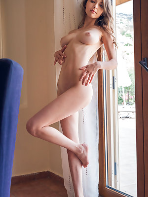 Glasses clad cutie Mila Azul looks hot with firm breasts naked in the window