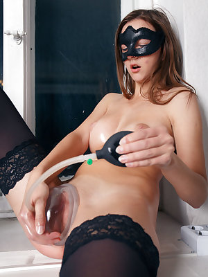 Masked Rebeka Ruby pumps her pussy and shows her swollen oiled lips
