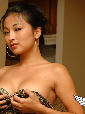 Hot Asian beauty Aria Lee bares her breasts and hikes her sexy dress