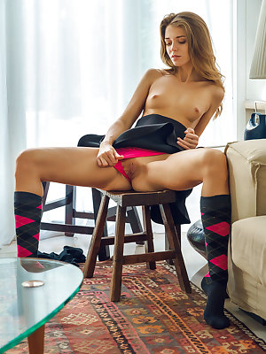 Teen solo girl Kalisy slips off pink panties and argyle socks to model naked