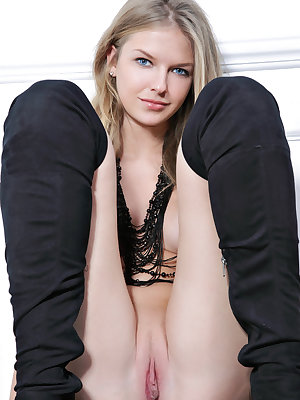 Russian solo girl Catherine A models naked in black, over the knee boots