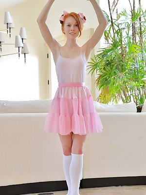 Skinny redhead teen in ballerina outfit jamming dildo up pink cunt