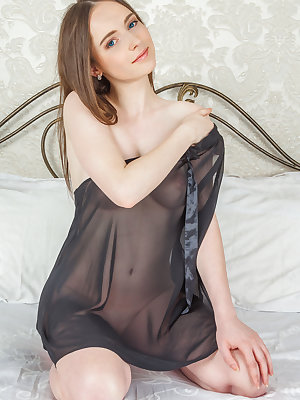 Little Nessie in black sheer lingerie giving a closeup of her tiny bald pussy