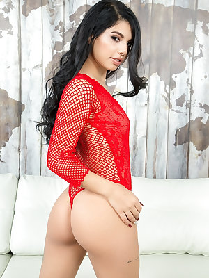 Sexy Latina model Gina Valentina slides her red onesie over her perfect ass