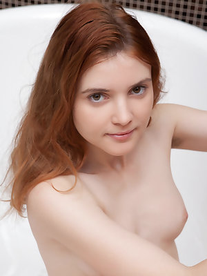 Cute redhead Orabelle Koivu shows her very hairy muff naked in the bathtub