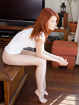 Petite ginger lassie Mia Sollis stretches her dripping wet pussy