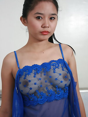 Young Asian hottie slips off see thru lingerie to model naked for first time
