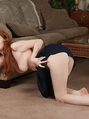Young redhead amateur Abbey Rain showing off big naturally hanging tits