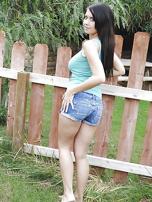 Young and busty teen babe in denim shorts releases big natural boobs