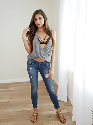 Cute young Nina North drops her jeans to show her juicy round ass & pussy