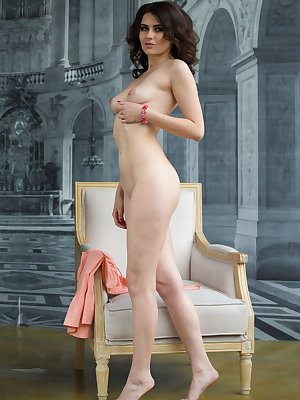 Beautiful brunette Viola shows her creamy body sprawled languidly on a chair