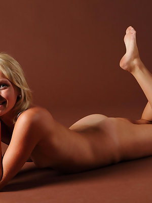 Young blonde Olga W peels off bra and panty set for nude posing