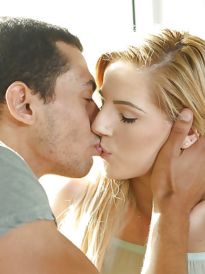 Young blond Bella Rose parking pierced cunt atop BBC during interracial sex