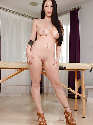 After undressing tasty pornstar Noelle Easton poses on a massage table