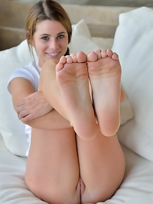 Gorgeous young minx likes licking her feet and fingering her wet cunt