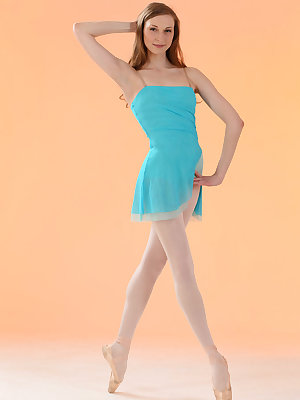 Flexible hot redhead Annett A in short dress & pantyhose stretching pussy wide
